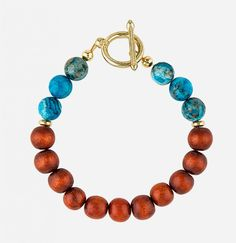 Wood/Turquoise Bead Bracelet design by Mister. Featuring a skull and bone lock…