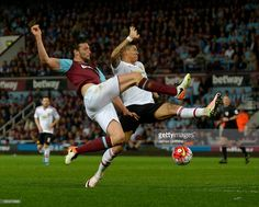 Andy Carroll of West Ham United in action with Manchester United's Chris Smalling during the Barclays Premier League match between West Ham United and Manchester United at Boleyn Ground on May 10, 2016 in London, England