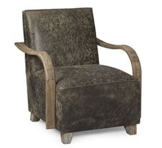 Ready for lounging, the retro Driskill Chair is upholstered in distressed leather and constructed with a comfortable foam seat. The curvaceous exposed wood arms meet in a back rail; the arms, rail and feet are hand rubbed finished with wire brushing that brings out the grain of the wood. #austincollection #arthomefurnishings #leatherchair #chair #livingroom #leather #livingroomfurniture