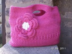 crochet bag...I have a ton of yarn right now that I'm looking for things to make. My flower would be more dainty or omitted. I'd probably opt to make a pattern with different colored yarn in the bag for more interest instead.  :)