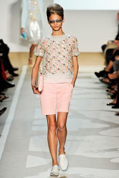 This designer was influenced by the 50s. Some key components are the bermuda style shorts. As well the shirt design surface. And the big hair. For accessories the look is complete by some glasses. 4.6.15