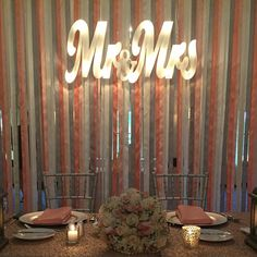 """What an incredible evening! Loved this marquee sign and ribbon backdrop for Jen + Mike's sweetheart table.. And of course the touch of sparkle on the table #powersoflove #weddingpowers #wedding #sweethearttable #weddingtable #bride #groom #mrmrs #pink #coral #silver #weddinginspiration #farmingtongardens #williamparkinsonevents #wpe"" Photo taken by @williamparkinsonevents on Instagram, pinned via the InstaPin iOS App! http://www.instapinapp.com (06/07/2015)"