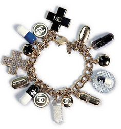 oh I looooove the Chanel pills! If a Chanel pill doesn't cure what ails ya, well, just pick a cute outfit to be buried in! Chanel Bracelet, Chanel Jewelry, Jewelery, Mademoiselle Coco Chanel, Bijou Box, Chanel Couture, Chanel Chanel, Gucci, Bracelets