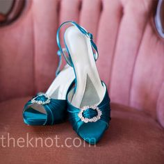 Katelyn's shoes matched the dark teal dresses the bridesmaids wore, while the brooch attached to the toes coordinated with the details in her gown.