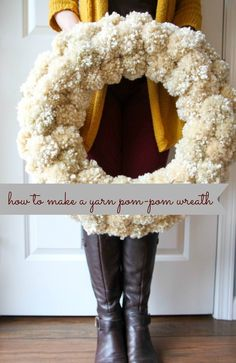 How to Make a Yarn Pom-Pom Wreath from MomAdvice.com... Adorable!! Great from Christmas thru Spring!