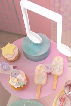 Don't miss this fun pastel TikTok birthday party! The cupcakes and cakesicles are so cool! See more party ideas and share yours at CatchMyParty.com