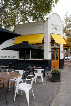Yellow awnings with Black Market umbrellas make this setting.