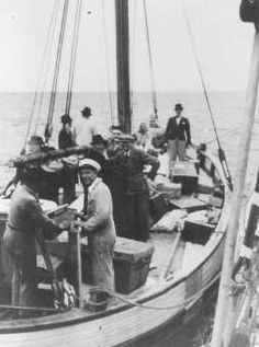 Danish fishermen (foreground) ferry Jews across a narrow sound to safety in neutral Sweden during the German occupation of Denmark. Sweden, 1943