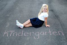 Instead of signs, have them sit on the driveway and write the grade with chalk. :) Cheaper and easier!