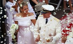Charlene and Albert were showered with rose petals as they made their way up the aisle as husband and wife.