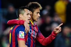 Alexis Sanchez (L) of FC Barcelona celebrates with his teammate Neymar after scoring his team's third goal from during the La Liga match between FC Barcelona and Granda CF at Camp Nou on November 23, 2013 in Barcelona, Catalonia.