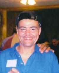 """Missing Man: Kent Jacobs --NC-- 03/10/2002; Age at Time of Disappearance: 41  Gender: Male  Race: Am. Indian  Height: 66 inches  Weight: 150 pounds  Hair Color: Black  Eye Color: Brown  Complexion: Medium    Identifying Characteristics: Tattoo of a small """"cross"""" on upper left arm.    Clothing: """"Harley Davidson"""" sweatshirt, blue jeans and """"Reebok"""" athletic shoes."""