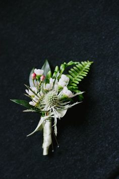<3 this boutonniere by http://ideas-in-bloom.com | Photo by http://fatorangecatstudio.com