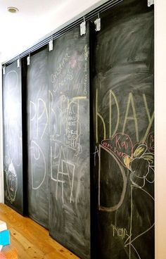 Chalk Board Overlapping Sliding Doors...How cool would this be for the basement between my room and the bathroom, Tess? Use tinted Chalkboard paint!