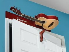 In a fix about what to do with your old, broken guitar? Here are 16 awesome recycling ideas to turn your old guitar into beautiful home decor items. Broken Guitar, Music Furniture, Deco Cool, Guitar Room, Ways To Recycle, Recording Studio, Home Decor Bedroom, Home Decor Items, Repurposed