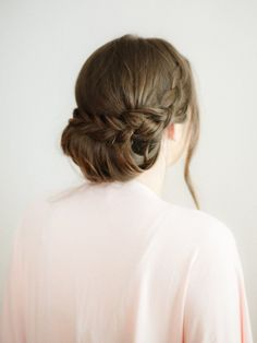 Step-by-step guide to the perfect braided hairstyle: http://www.stylemepretty.com/2016/03/27/braided-chignon-how-to-steps/ Photography: You Look Lovely