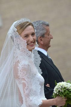 rtl.be: Wedding of Prince Amedeo of Belgium, Archduke of Austria Este, and Miss Elisabetta (Lili) Maria Rosboch von Wolkenstein, Rome, July 5, 2014-Lili wearing a couture gown by Valentino and Queen Elisabeth's Diamond Bandeau Tiara, which belongs to the Belgian Royal Family; the tiara is currently owned by Queen Paola, Amedeo's grandmother, who wore it for many years and also loaned it to her daughter-in-law Queen Mathilde to wear for her own wedding.