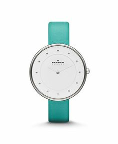 The Danish-inspired minimalist watch face paired with a rich turquoise leather band creates a sense of effortless elegance