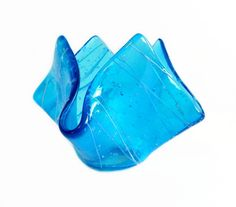 This unique art glass vase can be used as a candy dish, candle holder, or anything you like. Beautiful turquoise transparent art glass with