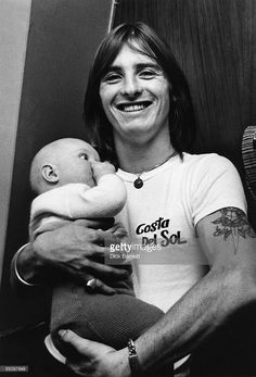 Photo of AC/DC and Phil RUDD; Portrait of Phil Rudd backstage with baby