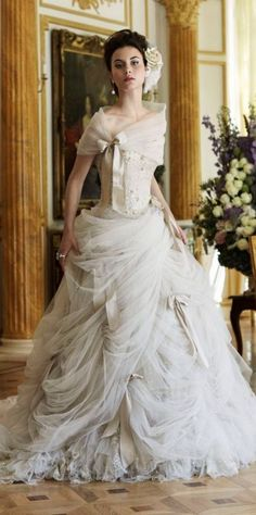 shawl and draping dress with bow steampunk wedding dress