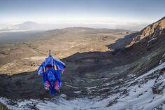 Valery Rozov makes the first ever wingsuit flight from Africa's highest mountain, Kilimanjaro. Rock Climbing Gear, Ice Climbing, Base Jumping, Bungee Jumping, Nepal Mount Everest, Brazil Carnival, Field Watches, Mount Kilimanjaro, Hang Gliding