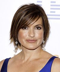 Mariska Hartigay. Casual Short Straight Hairstyle - This razor cut hairstyle sits perfectly to compliment the jaw-line with its perfectly cut layers all through the back and sides. The long side bangs add to the shape of the style and completes the look brilliantly. SUITABILITY INFO - Face Shape: Oval, Oblong, Square, and Diamond Styling Time: 20 minutes