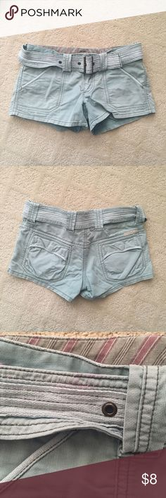 American Eagle Army Shorts American Eagle army shorts with belt and 2front/2 back pockets. Shorts have faded army look with stains on front of shorts and on belt (see pictures). 99% Cotton/1% Spandex. American Eagle Outfitters Shorts