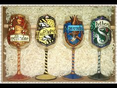 Harry Potter House Wine Glasses: Griffindor, Hufflepuff, Ravenclaw, and Slytherin.