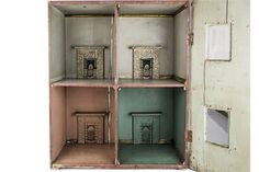 A late 19th century carpenter built dolls' house, a box back type with brick painted façade