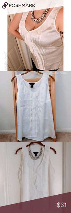 """{WHBM} 🆕 NWOT Silk Ruffle Top This sleeveless blouse from White House Black Market is absolutely gorgeous. It is 100% Silk. It's a beautiful ivory color with a ruffled neckline and pretty details down the front. Elegant yet sexy!  Material/care: 100% Silk. Dry clean only. Condition: NWOT. Only worn to try on.  Measurements flat: Chest: 20.5"""" Waist: 19"""" Length: 26"""" White House Black Market Tops"""