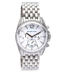 This sparkly women's watch from Michael Kors is composed of bright stainless steel with crystal accents around the bezel, on the case and as marker. The chronograph watch features three subdials as well as a date window at 6 o'clock.