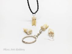 It's a replica of a human tooth in natural size, handcrafted with polymer clay. I made it as close to the real tooth as possible. Some slightly decayed spots are present, to justify the extra…