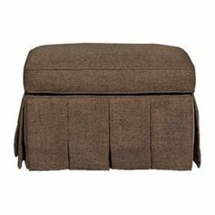 """Skirted ottoman with a velvet underskirt.  Product: OttomanConstruction Material: Wood and velvetColor: MinkFeatures: Pleated skirtDimensions: 19.5"""" H x 29"""" W x 21.5"""" D"""