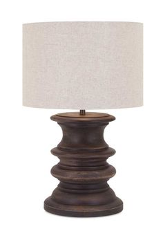 "Light up your room with this wide turned wood table lamp with a fabric drum shade. Product Description • Product Dimensions: 28"" H x 17"" D • Product Re-Shipper"