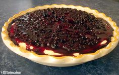 Enjoy a slice of rich and creamy no-bake huckleberry cheesecake pie made with tart wild huckleberries picked fresh off the bush. Huckleberry Desserts, Huckleberry Cheesecake, Cheesecake Pie, Cheesecake Recipes, Pie Recipes, Sweet Recipes, Dessert Recipes, Huckleberry Pie, Plated Desserts