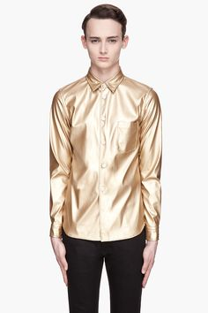 Comme Des Garons Homme Plus Metallic Gold Faux Leather Shirt -  Comme Des Garons Homme Plus Metallic Gold Faux Leather Shirt Comme Des Garons Homme Plus Long sleeve faux_leather shirt in metallic gold. Spread collar. Button closure and patch pocket at front. Shirttail hem. Tonal stitching. Single_button barrel cuffs. Price $465.00 Click HERE for more...
