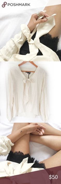 """NWT FLL Bell Sleeve Hi-Lo Bow Blouse Always Authentic🌸 For Love & Lemons flowy top. Higher in front and longer in back; v-neck w/ bow ties at front. Absolutely gorgeous! Small light makeup mark from where someone tried on in store (I purchased it like this) that will come out w/ dry-cleaning. 100%rayon. Approx measures: 17.5""""shoulder, 22-26""""length, 26""""sleeve, 21""""chest. *I personally style all pics, NO add'tl modeling* NO TRADES EVER! Lowest & FINAL price is already listed. Bundle &save even…"""