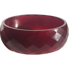 Bakelite Bangle Bracelet Carved in Translucent Cranberry  http://www.rubylane.com/item/414808-4400/Bakelite-Bangle-Bracelet-Carved-Translucent-Cranberry