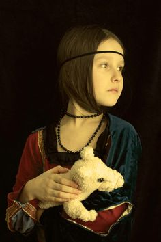 """""""Lady with a Bearmine"""" . Lady with an Ermine. Leonardo da Vinci. Kids costume inspired by art. I made it for my daughter's school custume party. I used an old T-shirt, goldern ribbon and a piece of velvet throw.  Cute teddy bear was tied up with string to resemble ermine - I admit this element was rather a failure :-)  """"Dama z gronostajem"""" - przebranie dla dzieci. www.photo42.ca"""