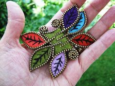 Zipper and felt brooches ... by woolly  fabulous, via Flickr - amazing, beautiful, lovely, gorgeous...