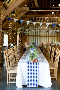 The reception was styled like a Cypriot Tavern with long banquet tables. Photography by Helen Cawte.