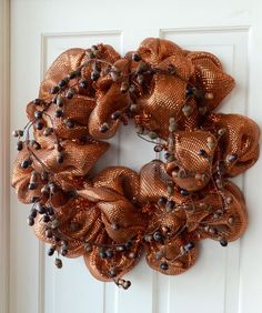 This website has lots of tutorials and ideas for those pretty mesh wreaths, and they also sell the supplies to make them.