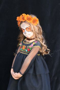 Cute way to modify those oaxaca embroidered shirts to dresses. Day of the Dead girl costume