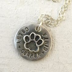 Pet memorial necklace This cat paw or dog paw necklace is a sweet reminder of your favorite pets. It also makes a lovely pet memorial necklace. The necklace can hold up to 22 characters/spaces combine
