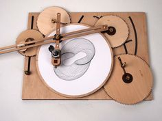 The Cycloid Drawing Machine by Joe Freedmanis a device similar to a Spirograph toy made using adjustable and interchangeable wooden gears that can be used to create elaborate and beautiful designs…