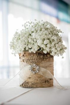 Find bouquet jewelry & natural wood tubes to create a rustic centerpiece like this one on our website: http://www.lightsforalloccasions.com/c-524-corsage-bouquet-supplies.aspx