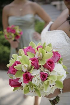 Lauren: Hydrangeas with hot pink roses and green cymbidium orchids.