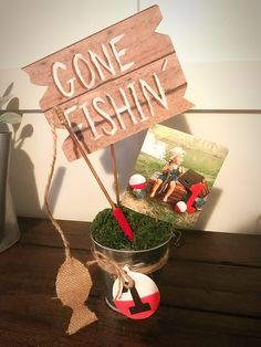 Fishing party centerpiece! I used a picture on here as inspiration and came up with this I LOVE how they turned out!! Fishing pole bobber gone fishing diy pictures: Gone Fishing First birthday! I diy'd EVERYTHING
