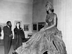 In 1956, BEN ENWONWU was commissioned to sculpt a bronze portrait of Her Majesty, Queen Elizabeth II. Artist and HRH viewing the final sculptural work.